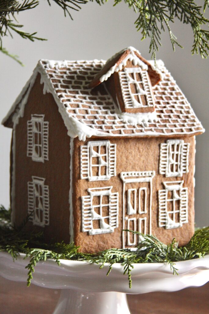 This image has an empty alt attribute; its file name is Homemade-Gingerbread-House-684x1024.jpg